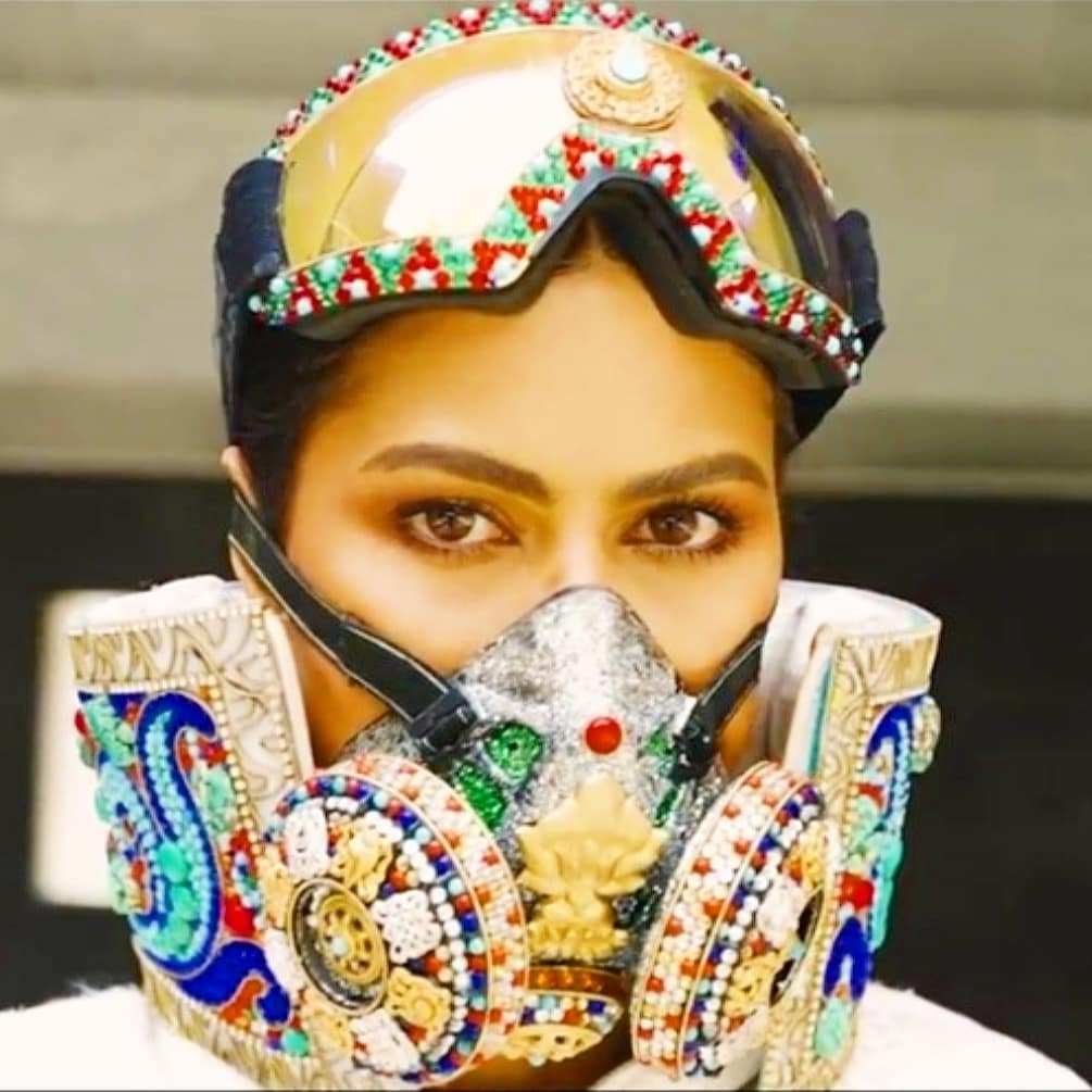 Miss Universe Nepal, Anshika Sharma wearing jewel crusted oxygen mask and protective gear with designs inspired by Tibetan designs for Miss Universe